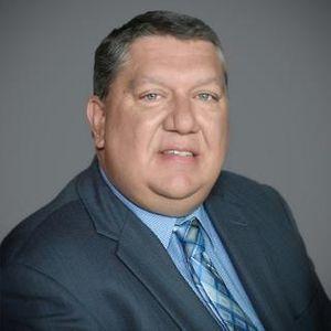 Photo of podcast host Dr. Greg Goins